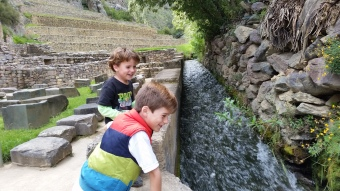 The boys learning about Incan irrigation systems, or just playing with the water
