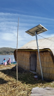 An Uros house with solar panel